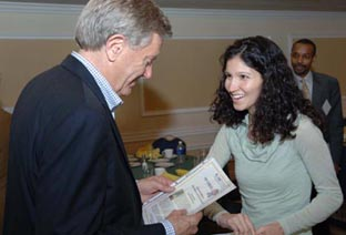 Planetizen Correspondent Lainie Herrera presents Bruce Babbitt with his Planetizen Top 10 Book Award certificate.