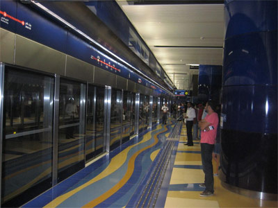 Dubai Metro: On the subway platform at Khalid Bin Al-Waleed, with automated doors that lead to the driverless trains.