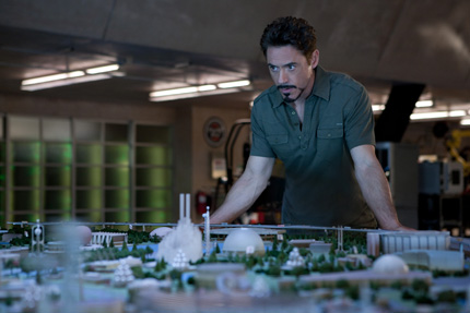 Photo: Robert Downey Jr. as Iron Man working in his lab.
