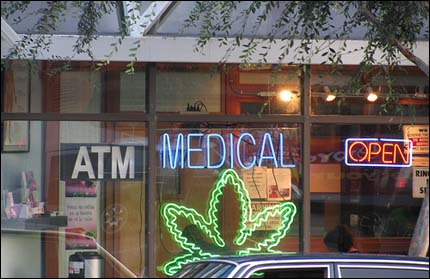 Photo: A neon pot leaf sign in a dispensary.
