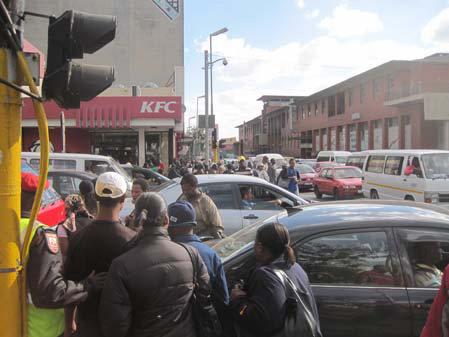 Pedestrians Struggling Through Joburg Traffic