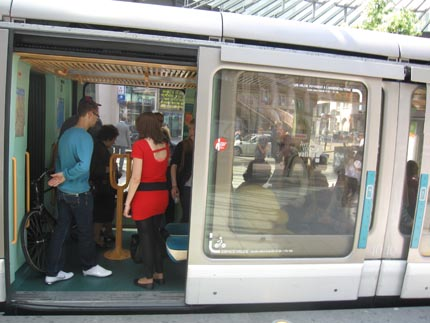 PHOTO: The open door of a tram, with a bicycle seen inside.