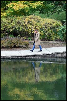 a woman walking in a park.
