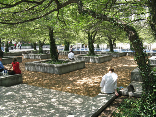 people sitting along tree boxes in chicago art institute's south garden