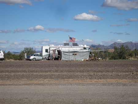 Old Glory flies high over many RVs at Quartzsite, which attracts a mainly aging, silver-haired and right-leaning crowd.